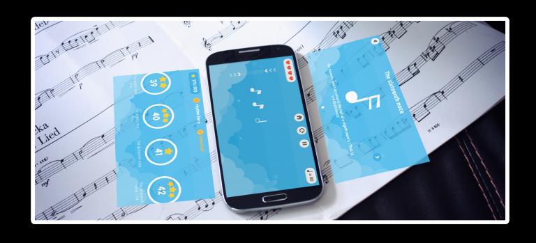 L'application Beat The Rhythm est comparée à une véritable méthode en papier. On retrouve des partitions et tablatures en papier ainsi qu'un smartphone posé par dessus avec des illustrations de l'application de rythme.